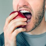 eating an apple with good teeth